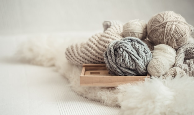 Cozy background wallpaper with the yarn for knitting. Free Photo