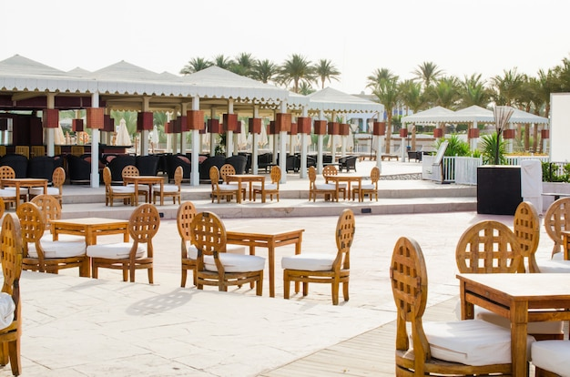 Cozy bar or cafe on territory of five star hotel with sea view in sharm el sheikh. Premium Photo
