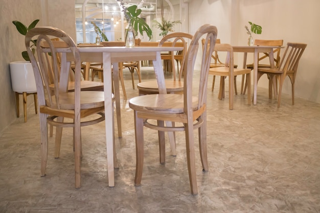 Cozy coffee shop with wooden furniture set Premium Photo