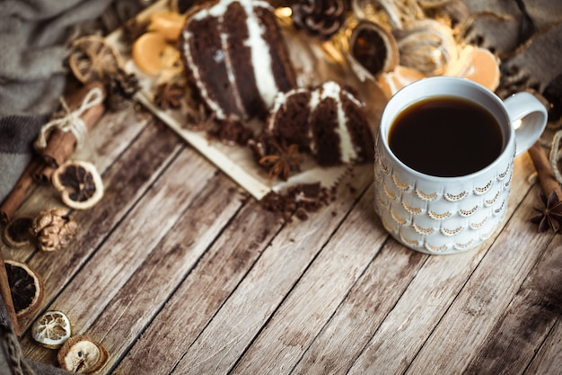 Cozy cup of tea and piece of cake Free Photo