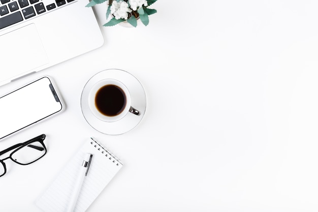 Cozy desktop with coffee and laptop Free Photo