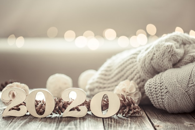 Cozy new year 2020 on wooden wall. Free Photo