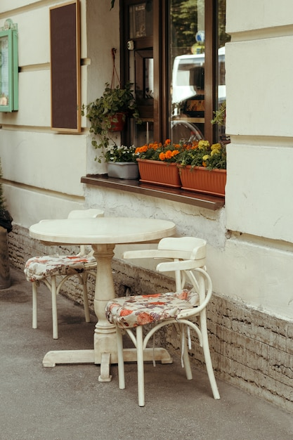 Cozy vintage  table of cafe in the  street Premium Photo