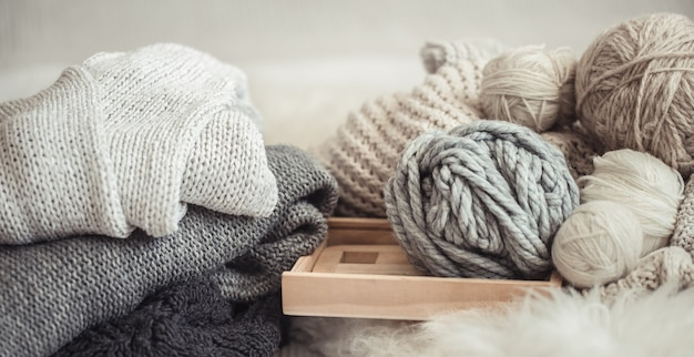 Cozy wallpaper with the yarn for knitting. Free Photo
