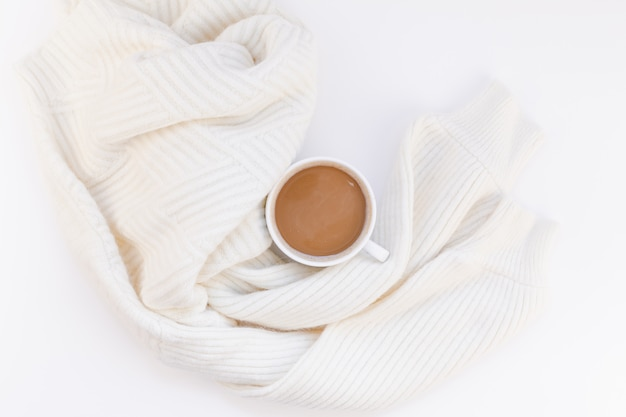 Cozy white warm sweater and coffee cup autumn mood Premium Photo