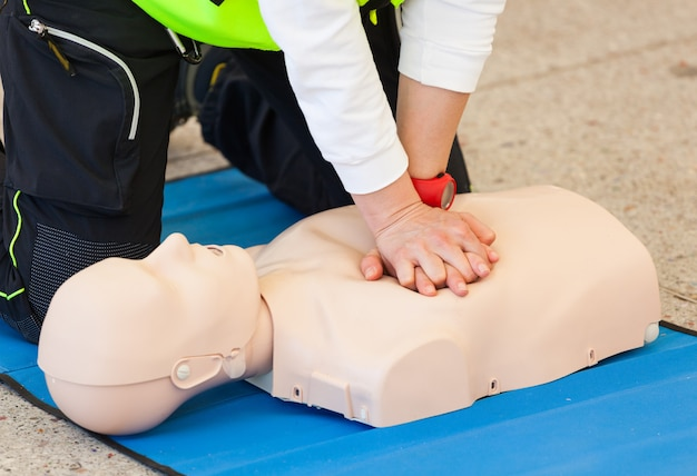 Cpr training with dummy Premium Photo