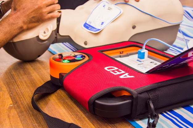 Cpr with aed training  and blur background Premium Photo