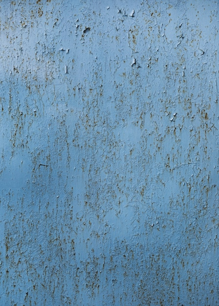 Cracked painted blue wall texture Free Photo