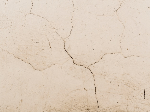 Cracked white wall textured background Free Photo