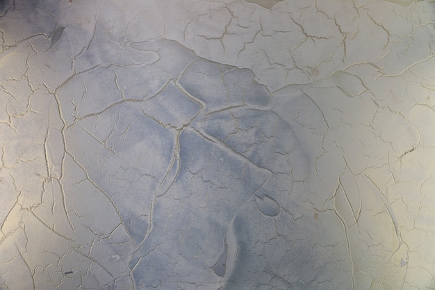 Cracks in rough concrete wall surface Free Photo