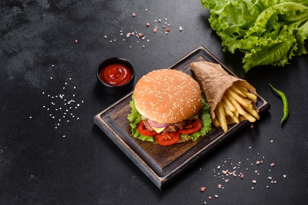 Craft beef burger and french fries on a black background Premium Photo