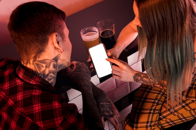 Craft beer concept with hipster couple Free Photo