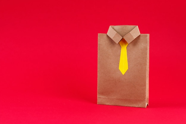 Craft packages gifts for father's day in the form of a shirt and tie, a gift for father day, Premium Photo