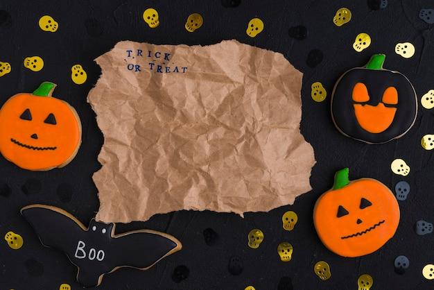 Craft Paper Between Halloween Biscuits And Ornamental Skulls