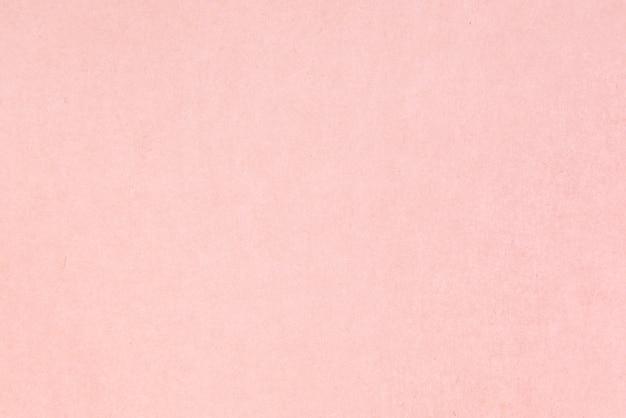 Craft paper pink or rose gold textured. valentines day background Premium Photo