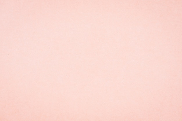 Craft paper pink or rose gold textured. valentines day background Premium Photo
