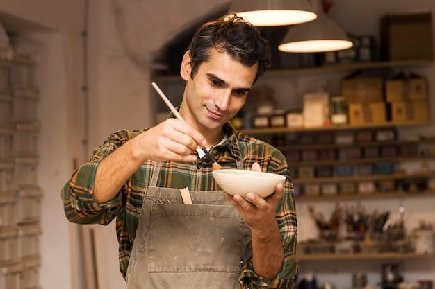 Craftman in workshop Premium Photo