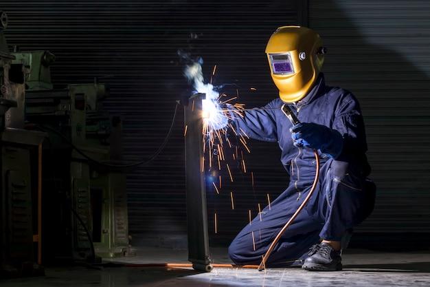 A craftsman is welding with workpiece steel. Premium Photo