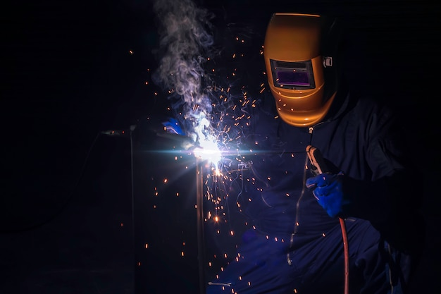 A craftsman is welding with workpiece steel. Premium Photo