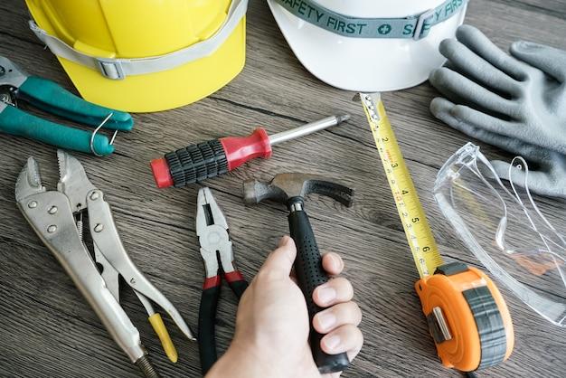 Craftsman tool, for man worker. hemmerin hand Premium Photo