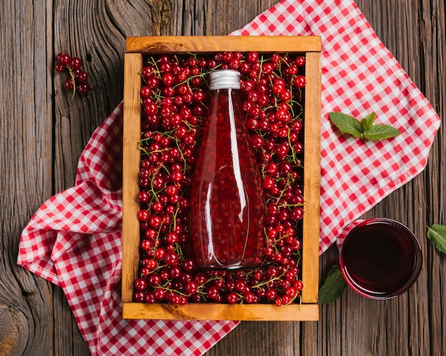 Cranberry juice bottle on wooden background Free Photo