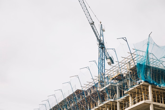 Crane and building under construction Free Photo