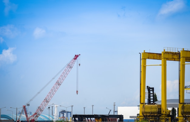 Crane and container ship in export and import business and logistics in harbor industry Premium Photo