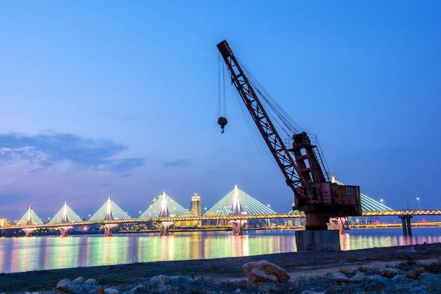 Crane on the waterfront pier Premium Photo