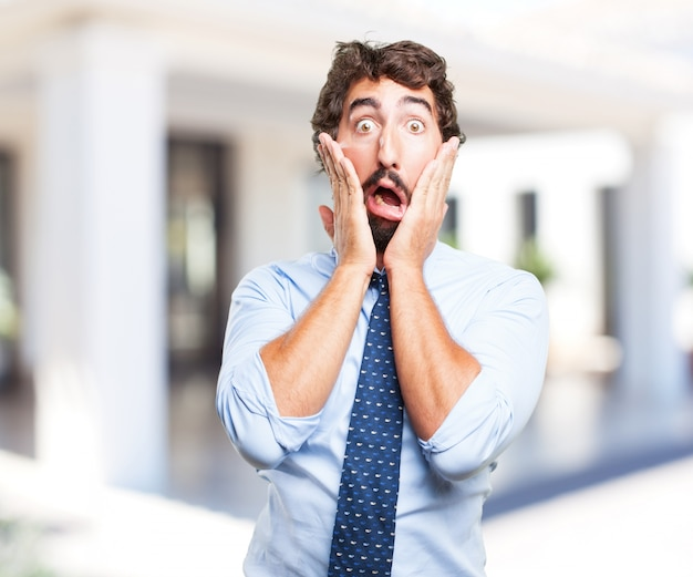 Crazy businessman worried expression Free Photo