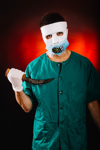 Crazy doctor with old dagger Free Photo