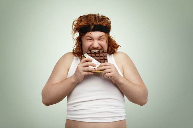 Crazy and hungry overweight young redhead european male with good appetite Free Photo