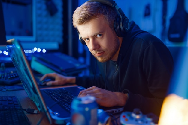 Crazy male gamer, gaming lifestyle, cyber addiction. computer games dependence, online videogame player in his room with neon light Premium Photo