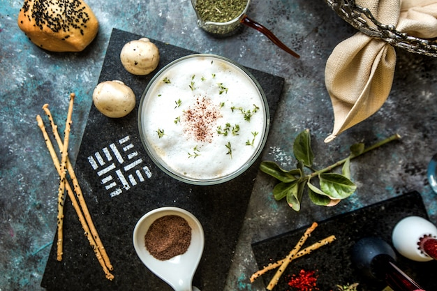 Cream mushroom soup served with herbs and spices. Free Photo