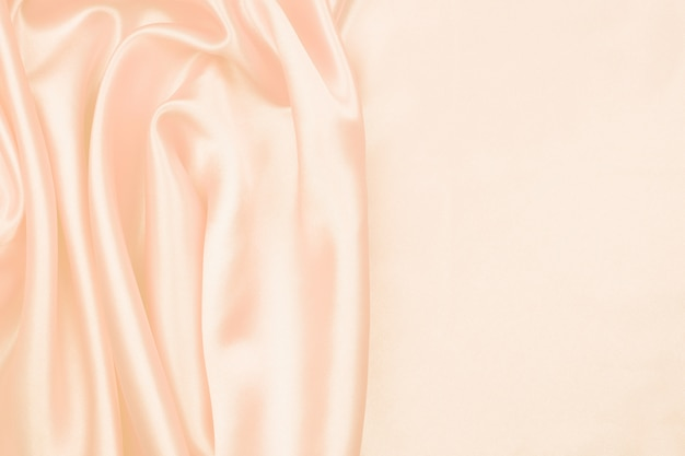 Cream silk texture luxurious satin for abstract background Premium Photo