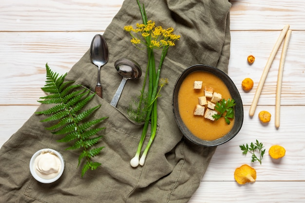 Cream soup from fresh forest  mushrooms chanterelles with croutons. Premium Photo