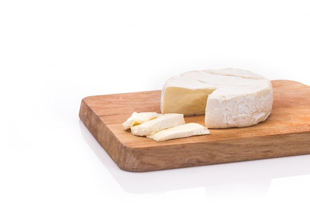 Creamy brie on rustic wooden background, top view Free Photo
