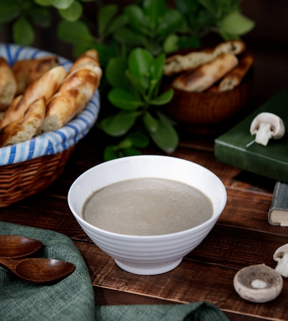 Creamy mushroom soup in a white bowl Free Photo