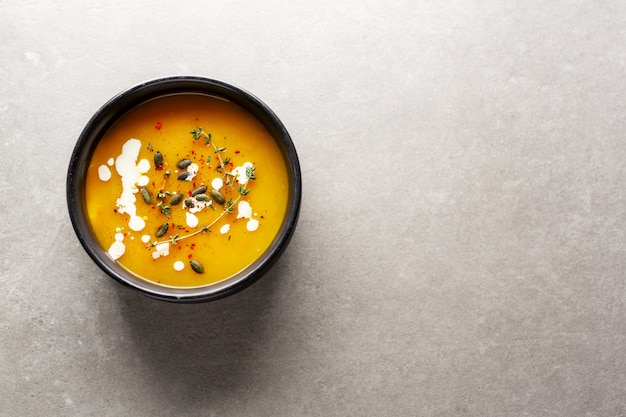 Creamy pumpkin soup served in bowl Free Photo
