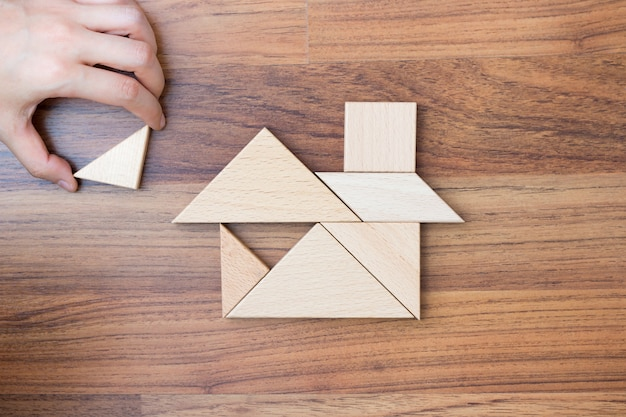 Creating or building dream home with puzzle piece. Premium Photo