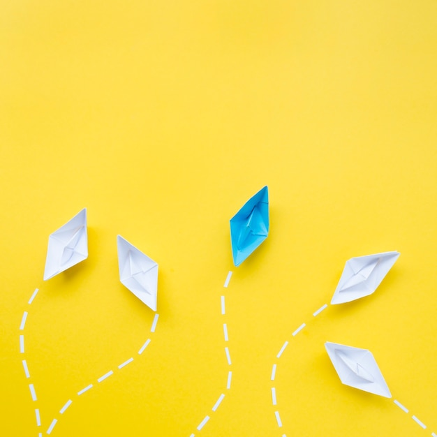 Creative arrangement for individuality concept on yellow background Free Photo