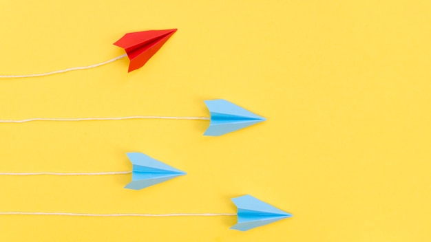 Creative arrangement with paper airplanes Free Photo