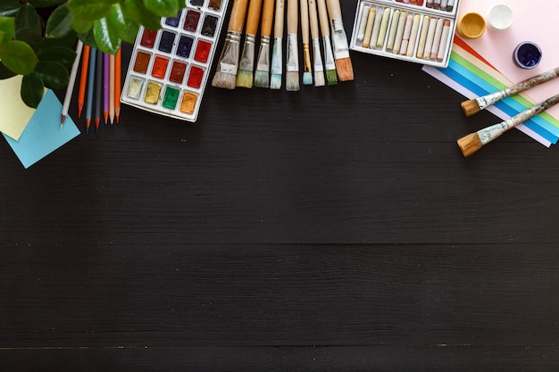 Creative art painting drawing supplies tools set on wooden desk top view Premium Photo