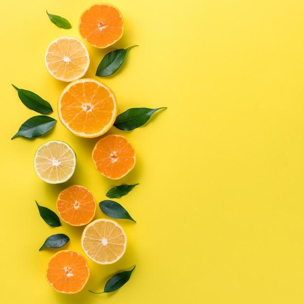 Creative background with tropical fruits. orange, lemon, lime, grapefruit Premium Photo
