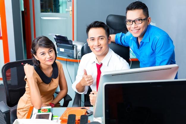 Creative business asia,team meeting in office Premium Photo