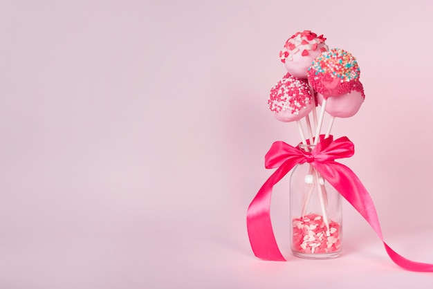 Creative cake pop concept Free Photo