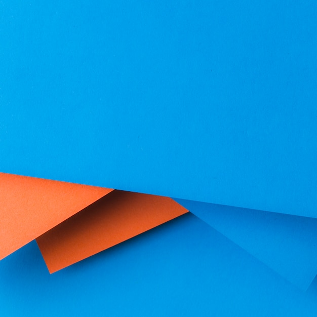 Creative design made with blue and an orange paper Free Photo