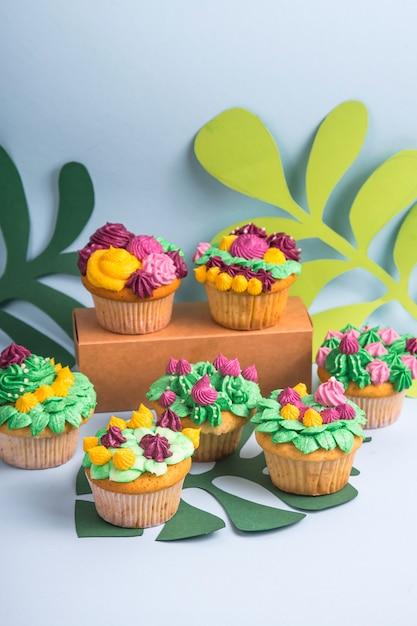 Creative dessert muffin with colorful cream decoration Premium Photo
