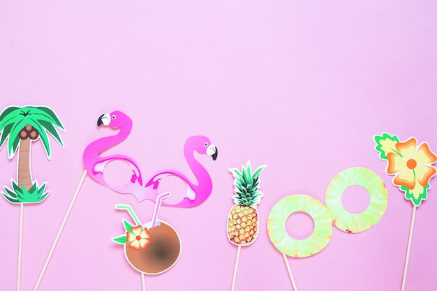 Creative flat lay of summer concept on pink colour background Premium Photo