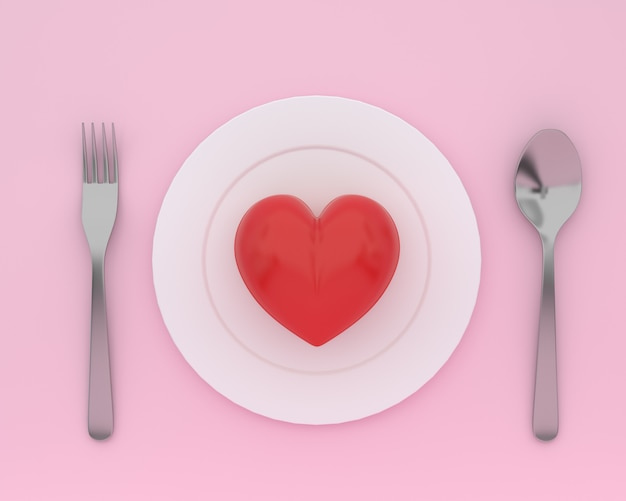 Creative of heart on plate with spoons and forks on pink color. minimal healthcare concept Premium Photo