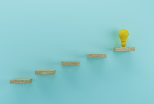 Creative idea and innovation. light bulb revealing an idea outstanding on wood background Premium Photo
